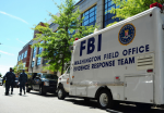 An FBI evidence response team collects evidence at Building 197 at the Washington Navy Yard. A gunman killed 12 people at the base. (U.S. Navy photo by  Pedro A. Rodriguez)