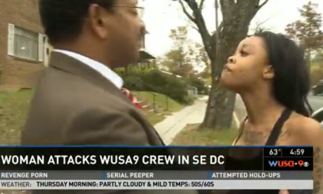 A woman confronts WUSA newsman Bruce Johnson outside a home in Southeast Washington on Wednesday.
