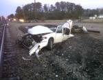An Amtrak train heading from Norfolk to Boston on Thursday, hit a 2000 Ford Crown Victoria that attempted to cross rail tracks in Waverly, Va., leaving this wreckage. The driver was recovering at a hospital. None of the passengers on board were injured. (Virginia State Police)
