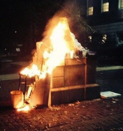 Police said a lampshade caught fire during student offerings at the Testudo statue early Wednesday. (Photo @aboyJustin)