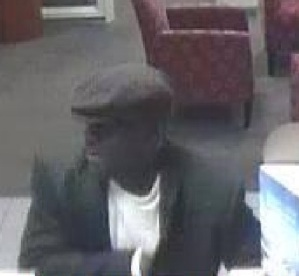 Police say this man walked into a Silver Spring bank with a kitchen knife Feb. 21, and stole money from the tellers.